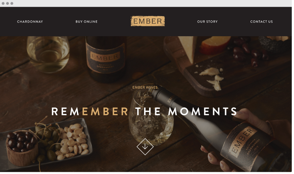 """Screenshot of Ember wines homepage. Rustic color with """"remember the moments"""" in the middle of the page against a background of someone pouring wine into a glass."""