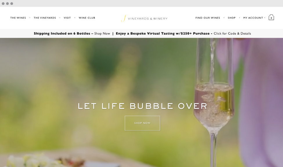 """Screenshot of J Vineyards website homepage. """"Let life bubble over"""" in white text in the middle of the page against a blurry green background with a champagne flute"""