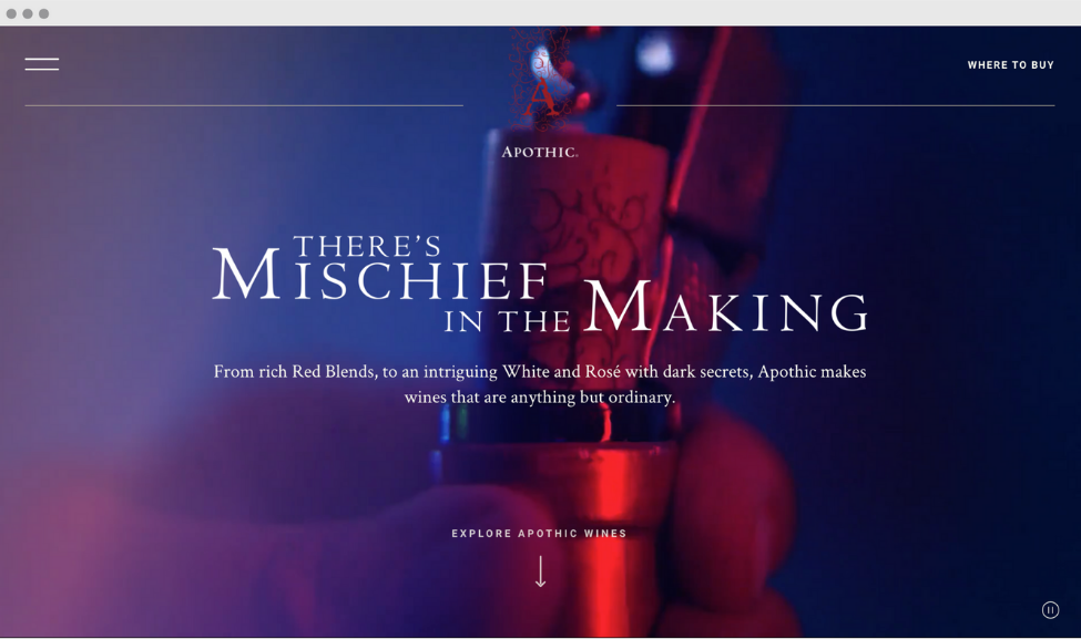 """Apothic Wine's webpage homepage. """"there's mischief in the making"""" in white text with hazy blueish purple background and someone holding the top of a wine bottle and the cork is being unscrewed"""